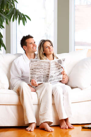 Young love couple reading magazine  in the comfortable apartment Stock Photo - 2835098