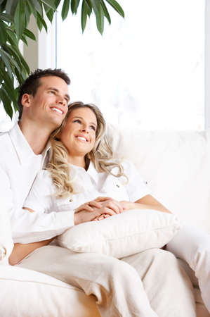 Young love couple smiling in the comfortable apartment Stock Photo - 2835094