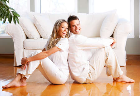 Young love couple smiling in the comfortable apartment Stock Photo - 2835101