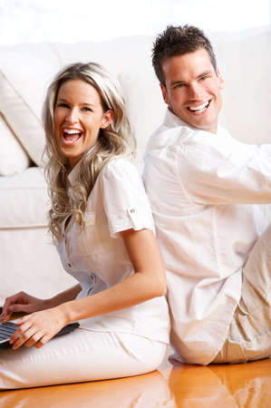 Young love couple smiling in the comfortable apartment Stock Photo - 2835119
