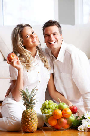 settler: Young love couple with fruits in the comfortable apartmentr