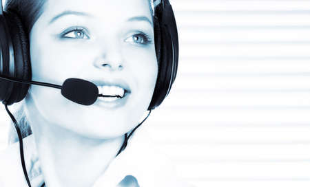 handsfree phones: Smiling pretty business woman with headset.