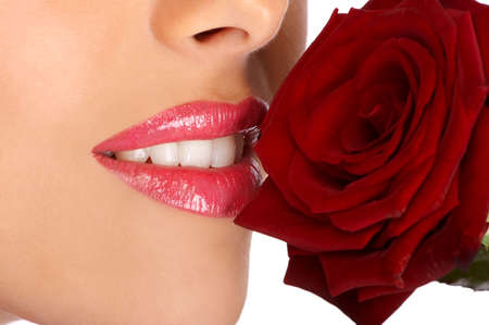 Young pretty woman holding and smelling red rose   Stock Photo