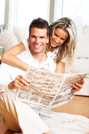 Young love couple reading magazine  in the comfortable apartment Stock Photo - 2898376