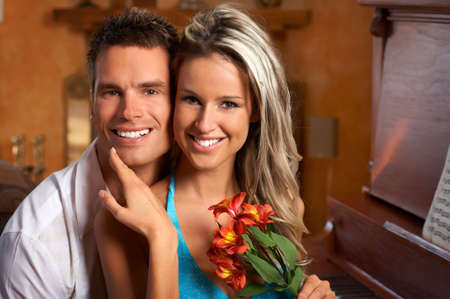 Young love couple smiling in the comfortable apartmentr photo