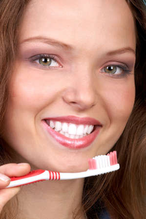 Smiling  young woman with healthy teeth holding a tooth-brush Stock Photo - 2904351
