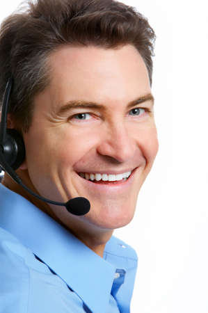 Smiling  businessman  with headsets. Over white background  photo
