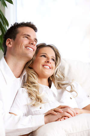 Young love couple smiling in the comfortable apartment Stock Photo - 2977244