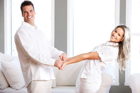 Young love couple smiling in the comfortable apartment Stock Photo - 2977159