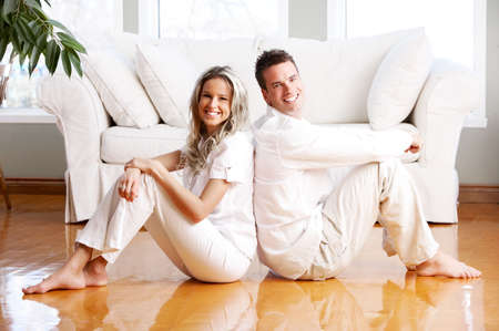 Young love couple smiling in the comfortable apartment Stock Photo - 2977249
