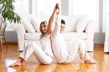 Young love couple smiling in the comfortable apartment Stock Photo - 2977240