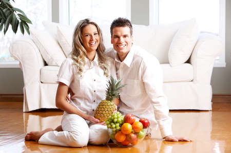 Young love couple with fruits in the comfortable apartment   photo