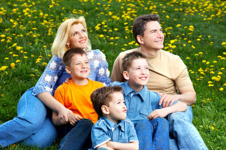 Happy family. Father, mother and sons in the park Stock Photo - 3042443