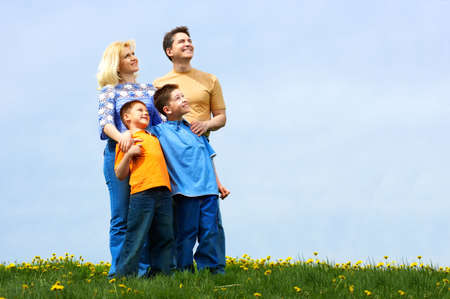 Happy family. Father, mother and sons in the park Stock Photo - 3042424