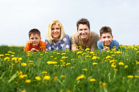 Happy family. Father, mother and sons in the park Stock Photo - 3042407