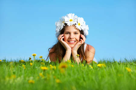 Beautiful woman with  flower diadem under blue sky