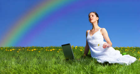 Beautiful young woman working with laptop under blue sky. Stock Photo - 3062720