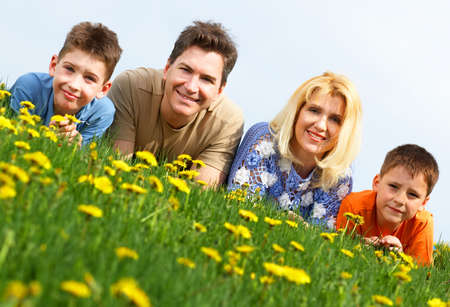 Happy family. Father, mother and sons in the park Stock Photo - 3062713