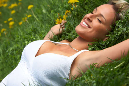 Beautiful woman with in the summer park Stock Photo - 3062733