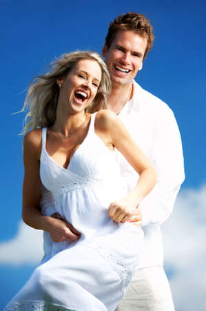 Young love couple smiling under blue sky Stock Photo - 3062722