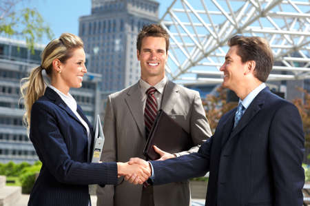 Business  meeting in the downtown. Businessmen and business woman  photo