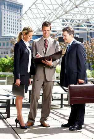 Business  meeting in the downtown. Businessmen and business woman Stock Photo - 3091868