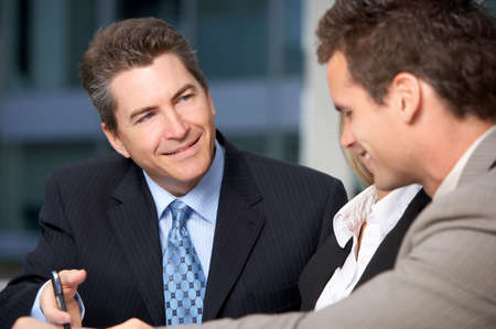 Business  meeting in the downtown. Businessmen and business woman Stock Photo - 3091862