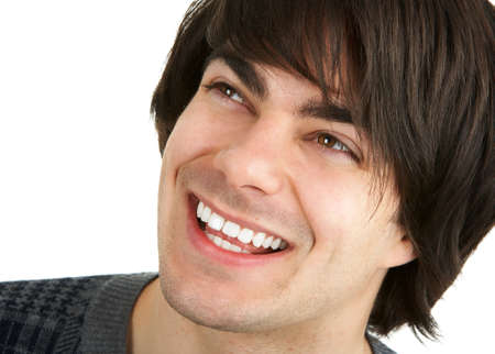 Face of a young smiling  man. Over white background Stock Photo - 3091964