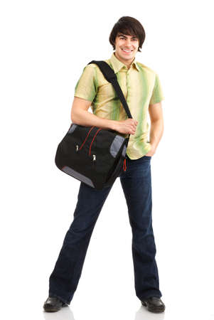 Young smiling  student with a bag. Over white background  photo