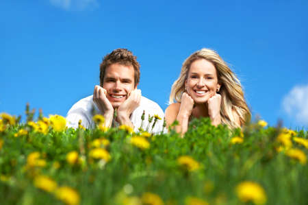 Young love couple smiling under blue sky Stock Photo - 3096640