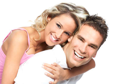 hugging couple: Young love couple smiling. Over white background  r