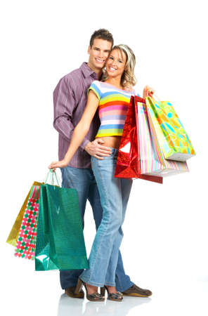 Shopping  smile couple. Isolated over white backgroundr photo