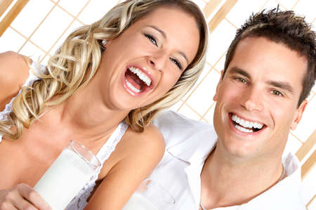 Young love couple  drinking milk. Over white background  r photo