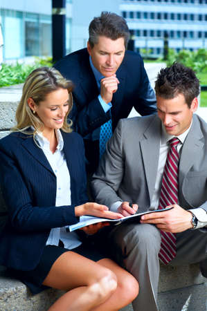 teamworking: Business people  meeting in the downtown. Businessmen and business woman