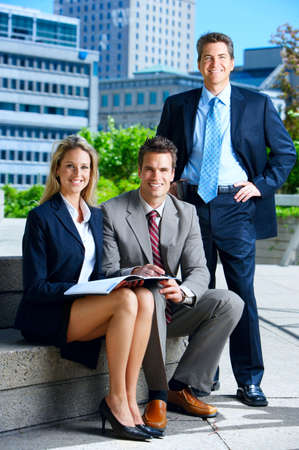 Business people  meeting in the downtown. Businessmen and business woman  photo