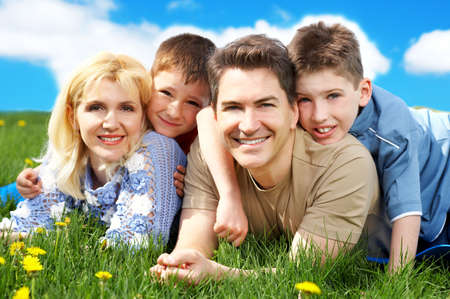 Happy family. Father, mother and sons in the park Stock Photo - 3119873
