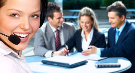 woman on phone: Beautiful  business woman with headset. Business people meeting