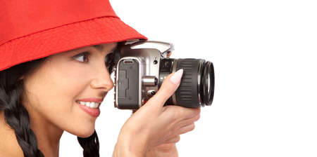 Young beautiful smiling woman holding a photo camera.  photo
