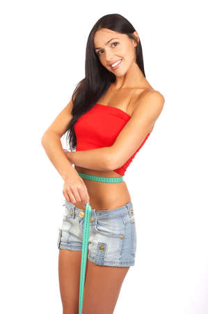 fatness: Young sexy woman measuring her waist. Isolated over white background