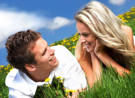 romantic sexy couple: Young love couple smiling under blue sky  Stock Photo