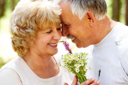 an old couple: Smiling happy  elderly couple in love outdoor r Stock Photo