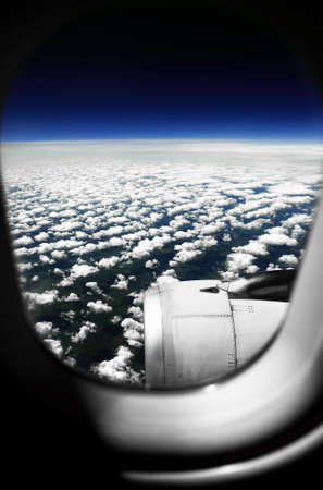 aeroengine: White clouds. View from the window of the plane  Stock Photo