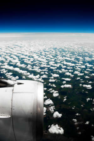 aeroengine: White clouds. View from the window of the plane