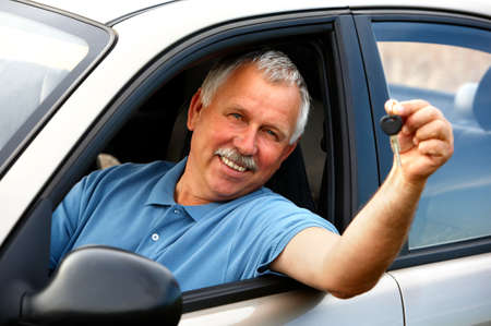 Smiling happy elderly man  in the new car Stockfoto