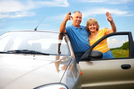 auto insurance: Smiling happy elderly couple  in the new car