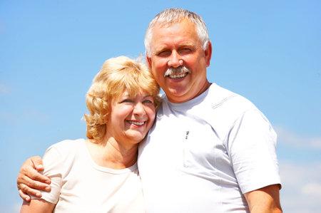 Smiling happy elderly couple in love outdoor   photo