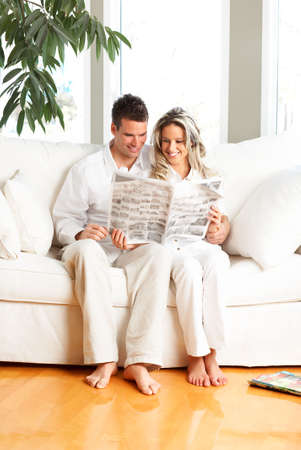 Young love couple reading magazine  in the comfortable apartment Stock Photo - 3531283