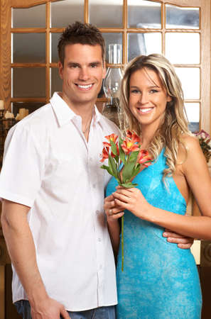 Young love couple smiling in the comfortable apartment\r photo