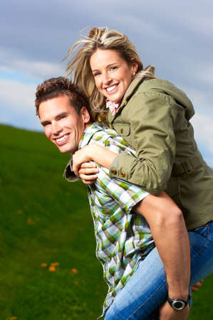 Young love couple smiling in the field  photo