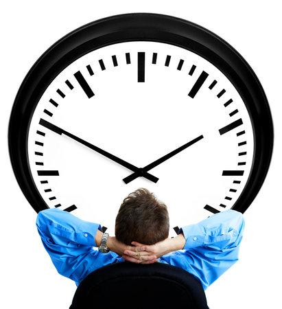 stipt: Knappe zakenman kijkt naar de klok. Over wit Stockfoto
